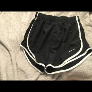 NIKE tiempo running shorts